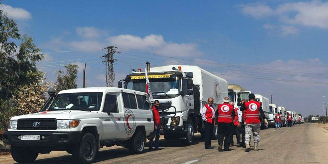 17-truck convoy of food aid delivered to two towns in Daraa by SARC