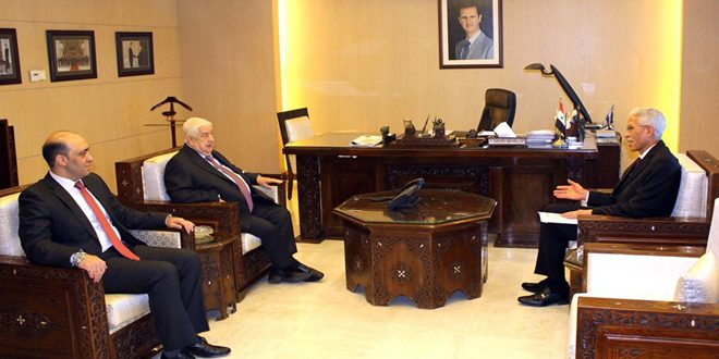 Al-Moallem receives copy of credentials of Algerian new Ambassador to Syria