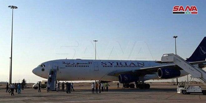 A plane carrying 188 Syrians stranded abroad arrives in Damascus Airport from the UAE