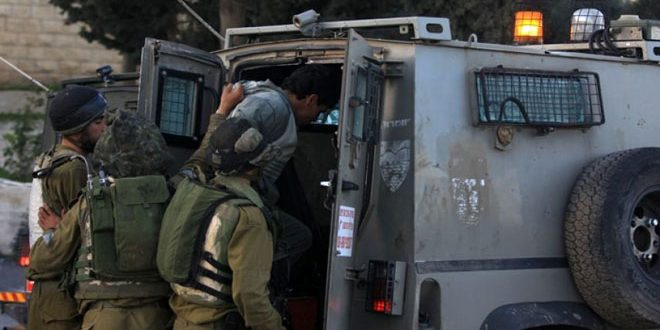 Occupation troops arrest six Palestinians in the West Bank