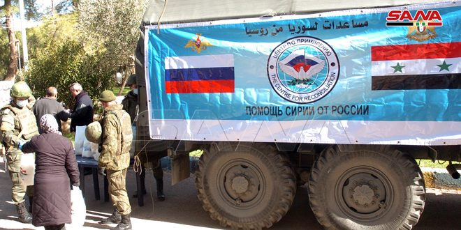 Russian Coordination Center distributes 255 food packages to displaced families in the make-shift center in Rassas town in Sweida