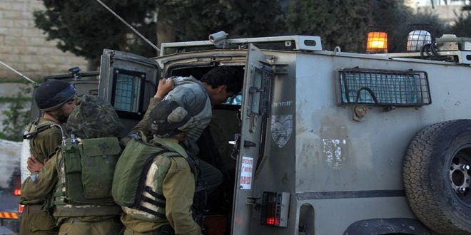 Occupation forces arrests a Palestinian Youngman in West Bank