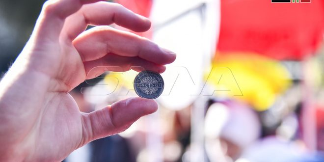 En fotos: Iniciativa para apoyar la libra siria