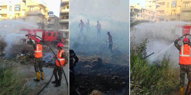 إخماد حريق نشب بالأراضي الزراعية في محيط قرية الغور الغربية بريف حمص